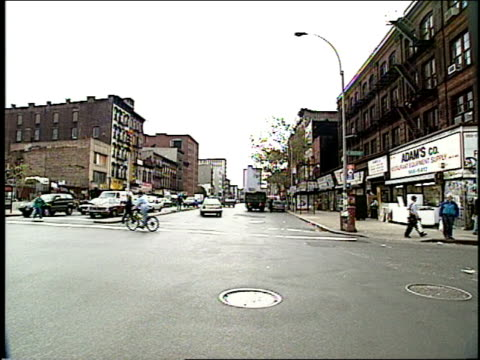 broll of 1994 bowery street in new york city filmed from a moving car - mtv1 stock-videos und b-roll-filmmaterial