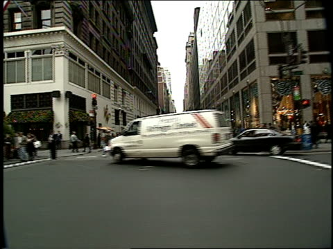 broll of 1994 midtown new york city streets filmed from a moving car - 1994 bildbanksvideor och videomaterial från bakom kulisserna