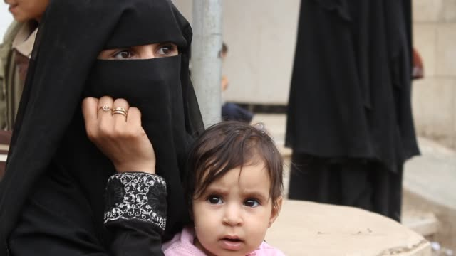 broll of a mother in burqa with her children at a refugee camp in sahban they were displaced due to the battle of amran - burka stock videos & royalty-free footage