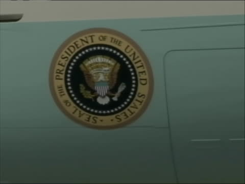 roll of air force one on tarmac. camera zooms in on the presidential seal. - care stock videos & royalty-free footage