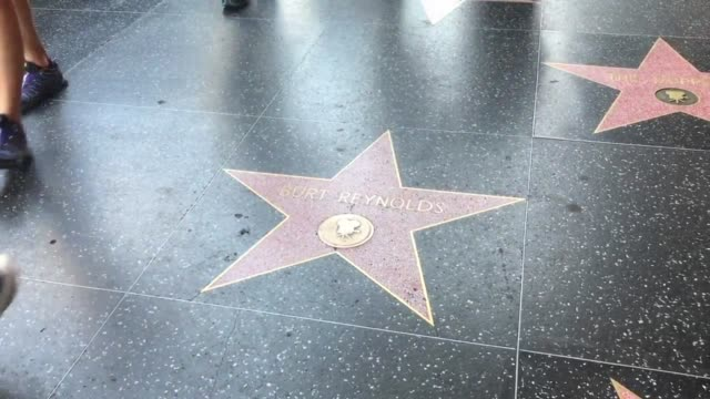 broll of burt reynold's star on the walk of fame - b rolle stock-videos und b-roll-filmmaterial