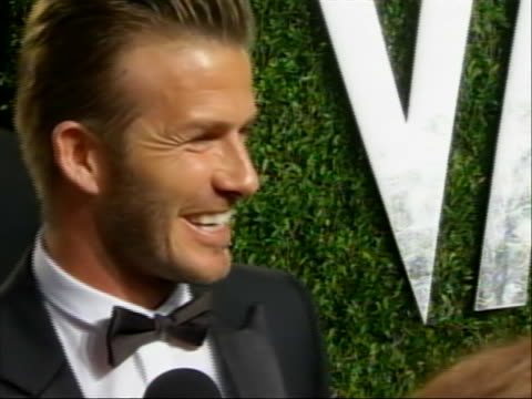 roll of david beckham on the red carpet of the 2012 vanity fair oscar party while talking to reporters. please note: this occurred after the academy... - oscar party stock videos & royalty-free footage