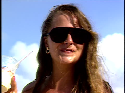 BRoll of Girl with Sunglasses and drinking in the Bahamas
