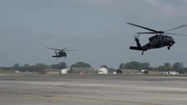 broll of helicopters flying as the 48th fighter wing bids farewell to the 56th rescue squadron during a ceremony at raf lakenheath united kingdom may... - 英国空軍点の映像素材/bロール