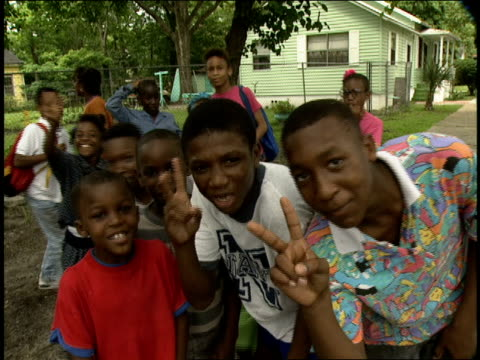 roll of kids smiling and saying peace to the camera - 1990 stock videos & royalty-free footage