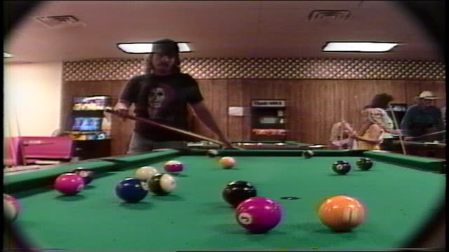 BRoll of Man Playing Pool in 1990