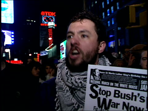 stockvideo's en b-roll-footage met roll of men yelling at protest in times square - irak