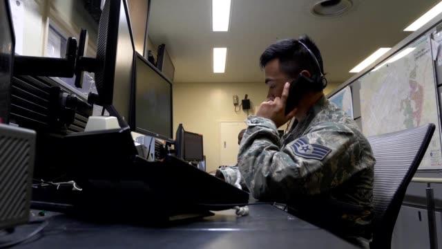 BRoll of military surveillance BDOC Controllers monitoring Kadena Air Base Okinawa Prefecture Japan April 27 2018 Image courtesy Airman 1st Class...