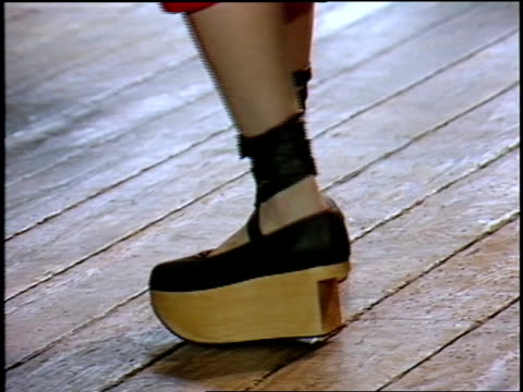 broll of model in clog type shoes modeling for camera - platform shoe stock videos and b-roll footage