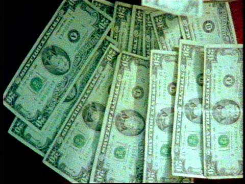 roll of money being counted - twenty us dollar note stock videos & royalty-free footage