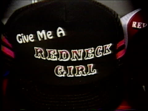 broll of novelty hats in 1990 store in missouri - ヒルビリー点の映像素材/bロール