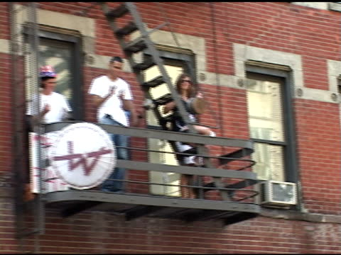 broll of people on fire escape banging pans in nyc - fire escape stock videos & royalty-free footage
