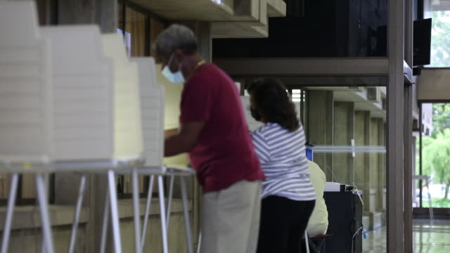 roll of people voting at different polling stations in the u.s. senate, u.s. house and state house 2020 primary elections during covid-19 pandemic in... - sezione elettorale video stock e b–roll