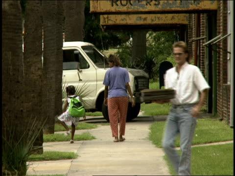 roll of people walking down a sidewalk in savannah - 1990年点の映像素材/bロール