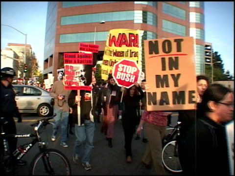 broll of protesters walking outside federal building in la - 2003 stock videos & royalty-free footage