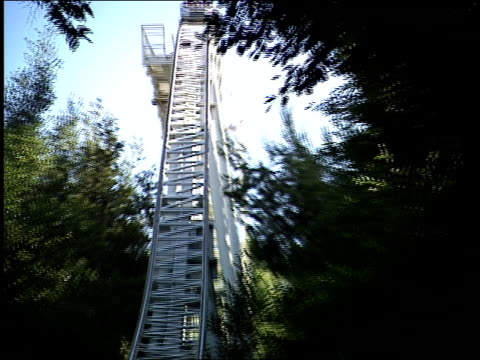 broll of roller coaster going by viper roller coaster at six flags magic mountain - サンタクラリタ点の映像素材/bロール