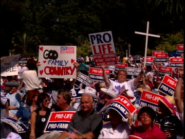 roll of signs and crowd at christian coalition rally in washington dc - christianity stock videos & royalty-free footage