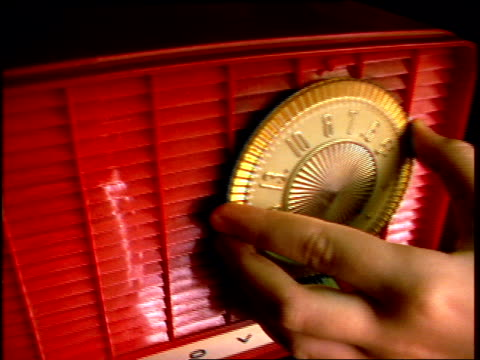stockvideo's en b-roll-footage met roll of someone using a vintage radio. circa 1990's - wijzer machineonderdeel