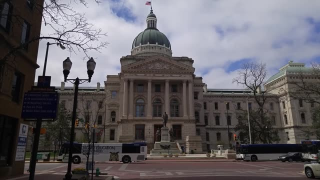 broll of the indiana state capitol building on the good friday holiday indiana's governor mike pence signed a bill on thursday that adds broad limits... - 長点の映像素材/bロール