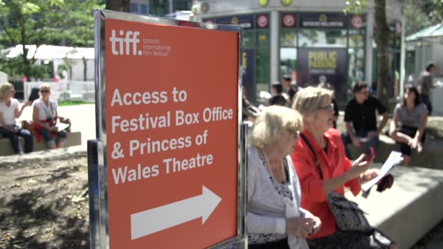 Broll of TIFF 2014 signage crowds and ETalk entertainment reporter on red carpets