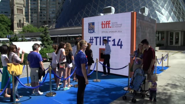 broll of tiff 2014 signage crowds screening arrivals and black suv arriving on red carpet - toronto international film festival stock videos and b-roll footage