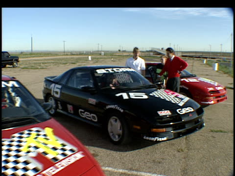 roll of various racecars to be in the grand prix, as well as b-roll of tommy lee and rachel bolan in their vehicles. no audio. - tommy lee musician stock videos & royalty-free footage