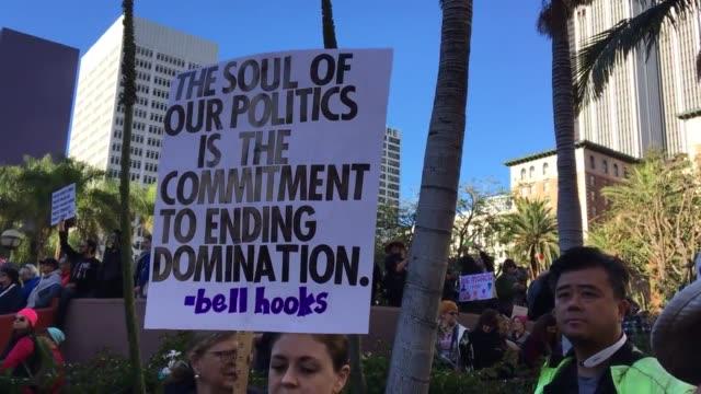broll of women's march on los angeles - lanci e salti femminile video stock e b–roll