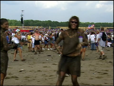 roll of woodstock 99 attendees covered in mud. - b roll stock videos & royalty-free footage