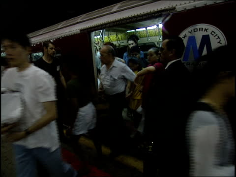roll people boarding subway with street performers singing - 1995 stock-videos und b-roll-filmmaterial