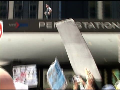 broll police watching crowd of protesters in nyc on top of msg marquee - b rolle stock-videos und b-roll-filmmaterial