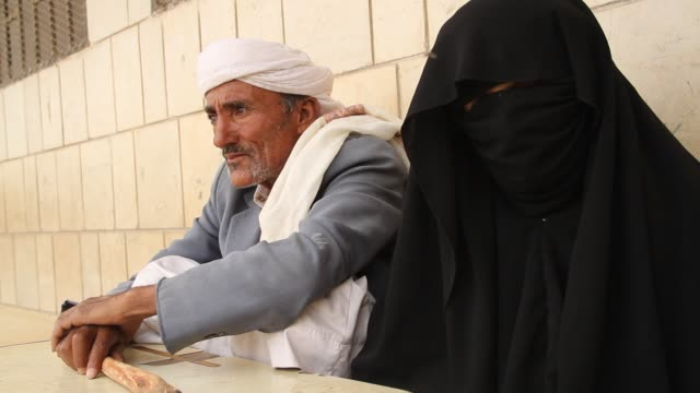 broll portrait of an old man's and his wife at a refugee camp in sahban he was displaced due to the battle of amran - senior men stock videos & royalty-free footage