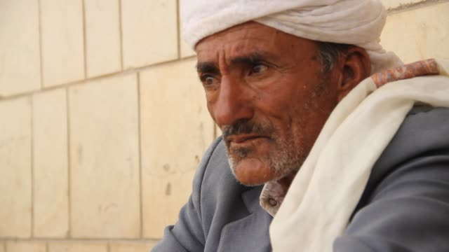 broll portrait of an old man's face at a refugee camp in sahban he was displaced due to the battle of amran - senior men stock videos & royalty-free footage