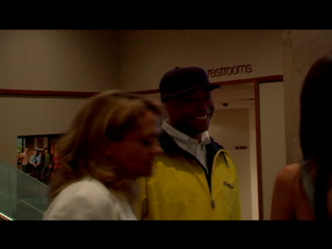 Broll Russell Simmons talking with Jerry Ferrara and girlfriend in movie theater's lobby NYC