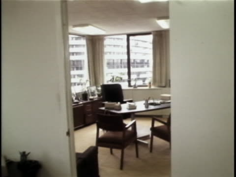 roll shot of democratic national committee office and desk of lawrence o'brien at the watergate complex. the watergate incident is a political... - resignation of richard nixon stock videos & royalty-free footage