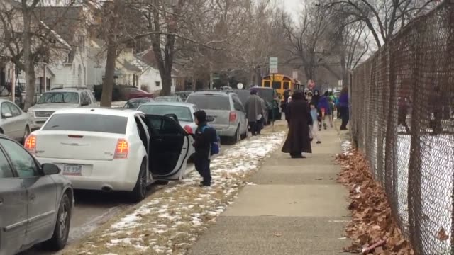 broll shots of children leaving school at the end of the day at gardner elementary a detroit public school clip one is sot with a parent who declined... - dearborn michigan stock videos and b-roll footage