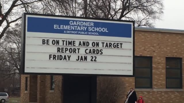 broll shots of children leaving school at the end of the day at gardner elementary, a detroit public school. clip one is sot with a parent, who... - employment document stock videos & royalty-free footage