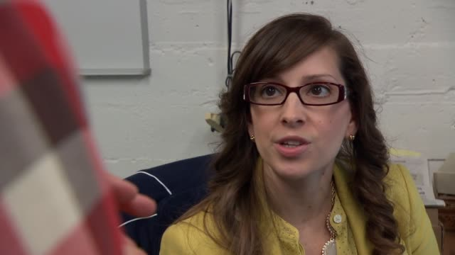 Broll shots of Task Rabbit CEO Leah Busque on June 5 Leah Busque speaks with a young white male Task Rabbit employee at their headquarters A tight...
