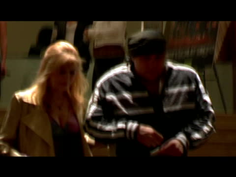 roll: steve and maureen van zandt walking arm in arm down stairs at new york city movie theater - スティーブン ヴァン ザント点の映像素材/bロール