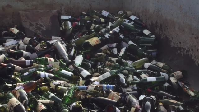 the us marshals service destroys more than 500 bottles of counterfeit and unsellable wine at a recycling/composting facility the wine is from the... - disposal container stock videos and b-roll footage