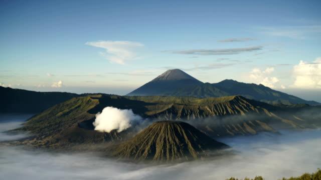 bromo volcano minor eruption with sunrise - bromo tengger semeru national park stock videos & royalty-free footage