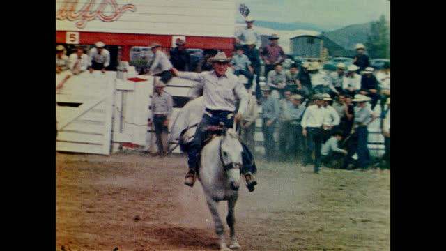1958 bronco busting at a rodeo - rodeo stock videos & royalty-free footage