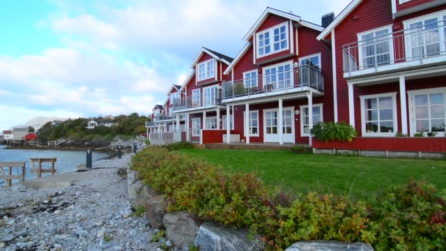 bronnoysund norway cruise hurtigruten colorful fishing house on water - standing water in yard stock videos & royalty-free footage