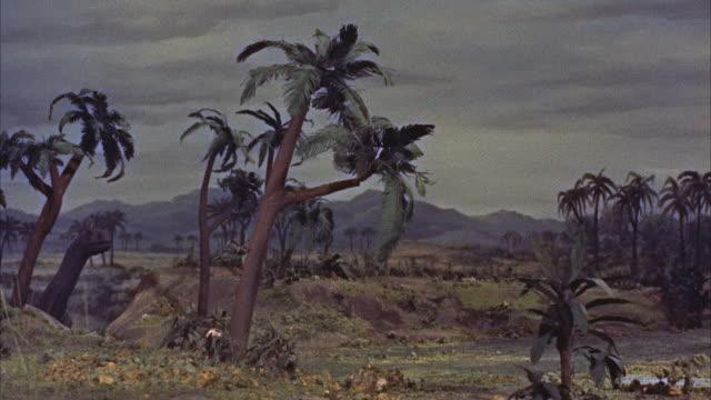 CGI, MS brontosaurus dinosaur in prehistoric landscape