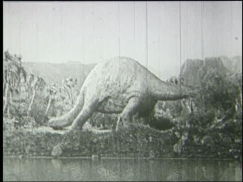B/W brontosaurus eating in jungle near river lifts its head