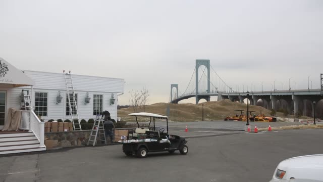 bronx new york us march 30th 2015 photographer victor blue exterior shots of construction workers tending the grounds outside of the trump golf links... - golf links stock videos & royalty-free footage