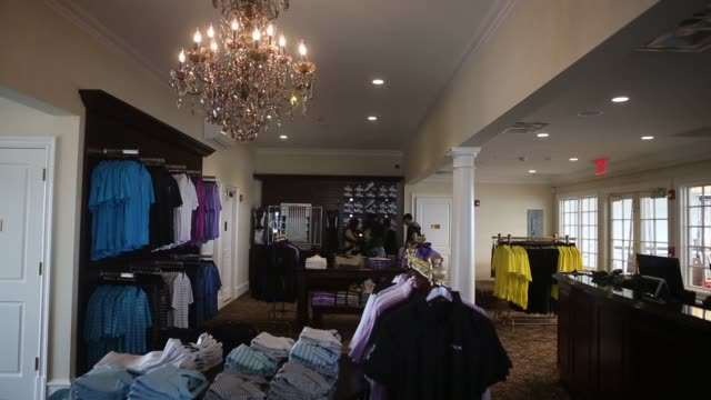 bronx, new york, u.s. march 30th, 2015. photographer: victor blue, interior shots of merchandise on display inside the trump golf links pro shop in... - golf links stock videos & royalty-free footage