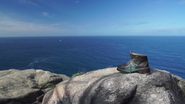 ms bronze boot at the end of the camino in finisterre - galicia stock videos & royalty-free footage