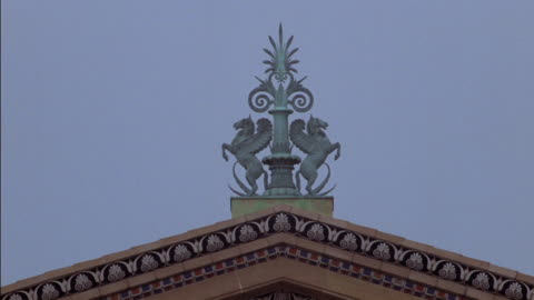 a bronze horse statue sits on a roof. - animal neck stock videos & royalty-free footage