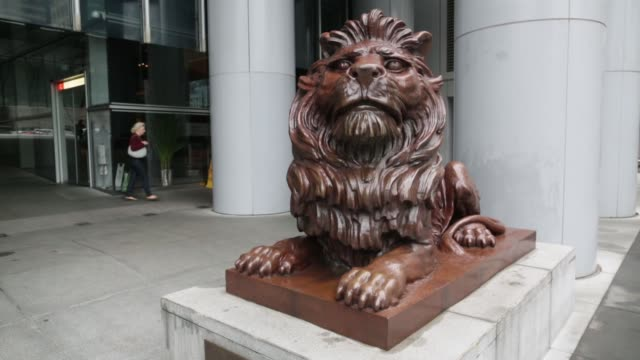 Bronze lion statue outside the HSBC Hong Kong headquarters office building General Images of HSBC And Standard Chartered Banks Ahead of Earnings on...
