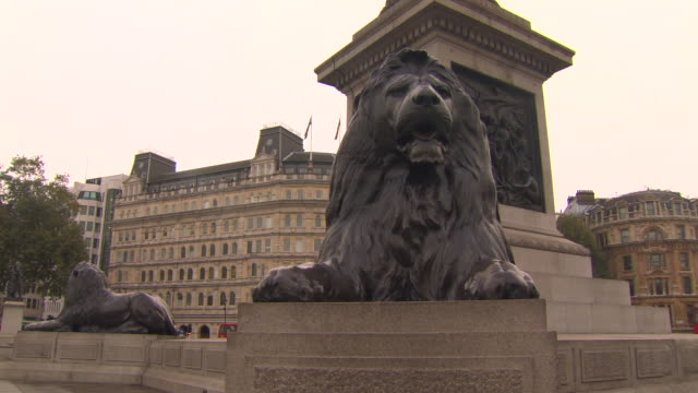 Bronze lions designed by Sir Edwin Landseer 'guard' Nelson's Column, Trafalgar Square, London, UK.